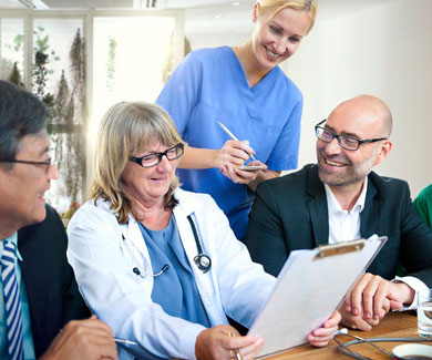 Healthcare professionals reviewing a document